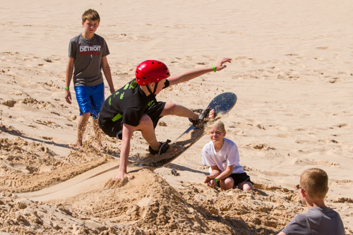 boys summer camp program near sand dunes